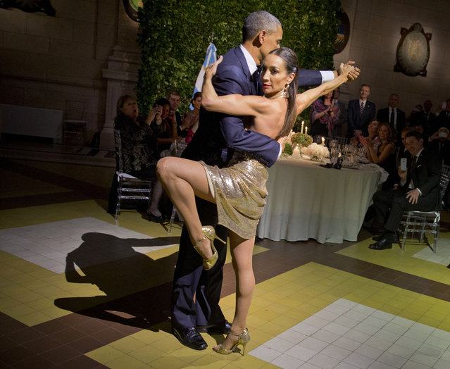 President Barack Obama with does the tango with a dancer during the State Dinner at the Centro Cultural Kirchner, Wednesday, March 23, 2016, in Buenos Aires, Argentina. (Photo by Pablo Martinez Monsivais/AP Photo)