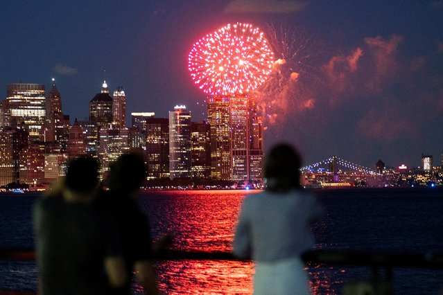 People watch fireworks in the New York City Harbor, as New York State celebrates reaching a 70 percent vaccination threshold for the coronavirus disease (COVID-19), as seen from Jersey City, New Jersey, U.S., June 15, 2021. (Photo by Eduardo Munoz/Reuters)