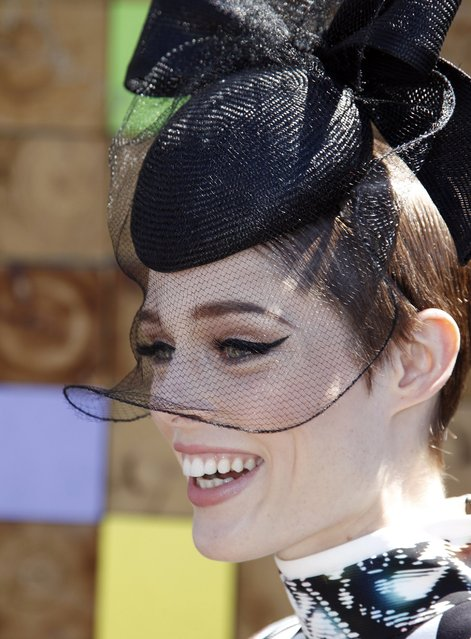 Canadian fashion model Coco Rocha poses for photographers before the Melbourne Cup at the Flemington Racecourse in Melbourne November 5, 2013. (Photo by Brandon Malone/Reuters)