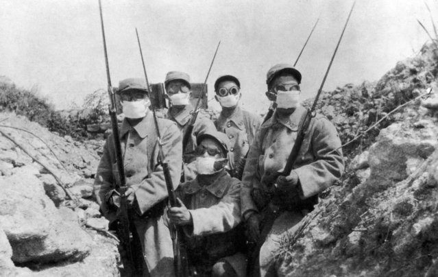 French troops wearing an early form of gas mask in the trenches during the 2nd Battle of Ypres, circa 1915.  (Photo by Hulton Archive/Getty Images)