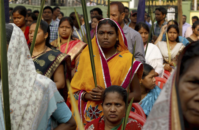 Indian Christians hold palm leaves at a mass to mark Palm Sunday in Bhubaneswar, India, Sunday, March 29, 2015. Christians comprise 2 percent of India's more than 1.2 billion people. (Photo by Biswaranjan Rout/AP Photo)