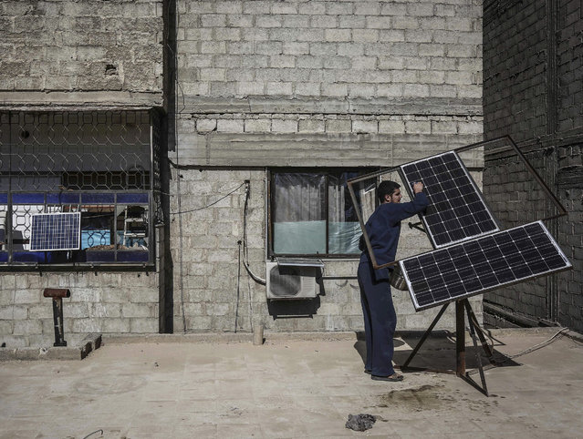 A Syrian man cleans a solar panel in the rebel-held city of Douma, outside Damascus, Syria, 05 February 2016. Syria's eastern Al-Ghouta province has been widely cut off from the power grid with solar panels being the only reliable source for electricity. (Photo by Mohammed Badra/EPA)