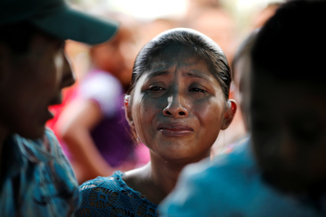 Claudia Maquin, mother of Jakelin Caal, a 7-year-old girl who handed herself in to U.S. border agents earlier this month and died after developing a high fever while in the custody of U.S. Customs and Border Protection, reacts during her daughter's funeral at her home village of San Antonio Secortez, in Guatemala December 25, 2018. (Photo by Carlos Barria/Reuters)