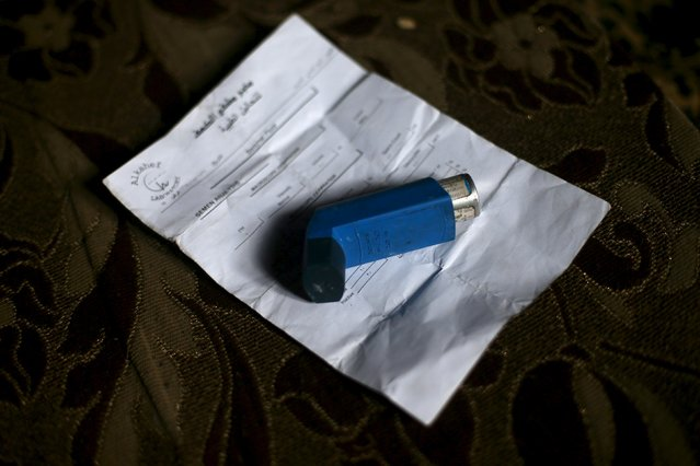 A bronchodilator is placed atop of a prescription treatment paper that belongs to Shahrour's son who is suffering from asthma, inside their home in the besieged town of Arbeen, in Damascus suburbs, Syria February 6, 2016. (Photo by Bassam Khabieh/Reuters)