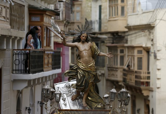 A statue of the Risen Christ is carried during an Easter Sunday procession in Cospicua, outside Valletta April 5, 2015. (Photo by Darrin Zammit Lupi/Reuters)
