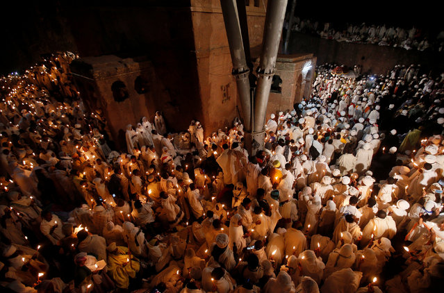 Ethiopian Orthodox pilgrims hold candles during Ethiopian Christmas Eve vigil around Bete Maryam (House of Mary) monolithic church in Lalibela, Ethiopia, January 7, 2017. (Photo by Tiksa Negeri/Reuters)