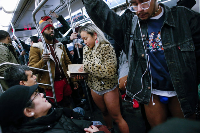 "People without pants travel in the subway during the ""No Pants Subway Ride"" in New York on January 8, 2017. (Photo by Kena Betancur/AFP Photo)"