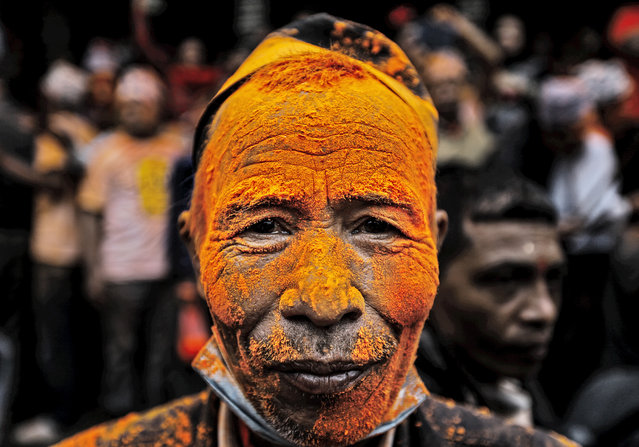 A man with coloured powder on his face during the Bisket Jatra Festival in Thimi, on the outskirts of Kathmandu, Nepal, 15 April 2015. The Bisket festival marks Nepali New Year 2072 and celebrates peace and harmony in the country. (Photo by Narendra Shrestha/EPA)