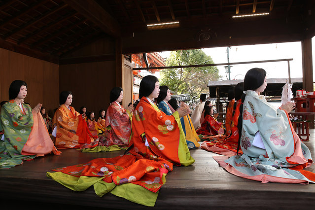 "Japanese women dressed in Heian Period (794–1192) costumes participate in the first ""Karuta"" card game of new year at Yasaka Shrine on January 3, 2014 in Kyoto, Japan. The traditional game is played each year to honour the shrine's deity Susanoo-no-Mikoto, the Shinto god of the sea and storms, who is also believed to have written the first tanka poem. (Photo by Buddhika Weerasinghe/Getty Images)"
