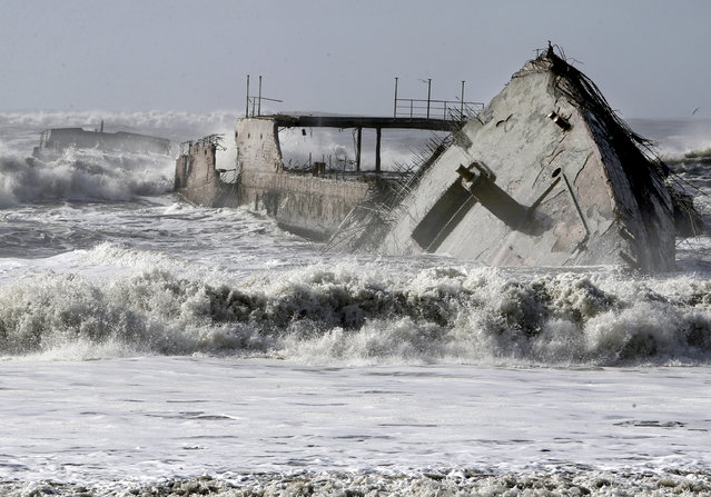 In this Saturday, January 21, 2017, photo, waves crash into the historic WW1-era ship called S.S. Palo Alto at Rio Del Mar in Aptos, Calif., after it was torn apart during a storm. (Photo by Kevin Johnson/The Santa Cruz Sentinel via AP Photo)