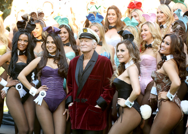 Hugh Hefner (C) poses with Playboy Bunnies, Playmate of the Year 2013 Raquel Pomplun (2nd L) and Miss December 2009 Crystal Hefner (2nd R) at Playboy's 60th Anniversary special event on January 16, 2014 in Los Angeles, California. (Photo by Rachel Murray/Getty Images for Playboy)