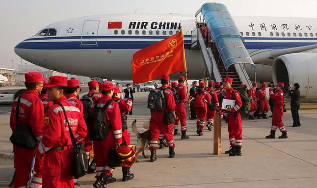 Members of Chinese International Search and Rescue Team and their rescue dogs board a charted plane to Kathmandu, after a 7.9 magnitude earthquake hit Nepal, at Beijing Capital International Airport, China April 26, 2015. (Photo by Reuters/Stringer)