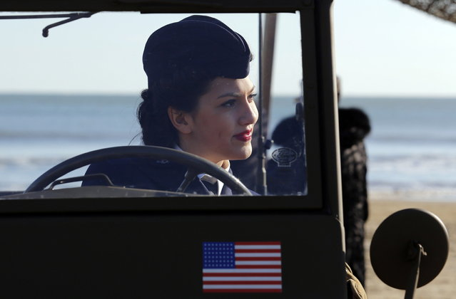A volunteer wearing the uniform of the U.S. army participates in the re-enactment of a World War Two landing to mark its 70th anniversary in Anzio, near Rome, January 25, 2014. (Photo by Stefano Rellandini/Reuters)