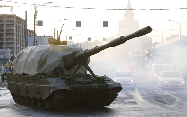 Russian servicemen drive a partially covered self-propelled howitzer Koalitsiya-SV along a street before a rehearsal for the Victory Day parade in Moscow, Russia, April 29, 2015. Russia will celebrate the 70th anniversary of the victory over Nazi Germany in World War Two on May 9. (Photo by Maxim Zmeyev/Reuters)