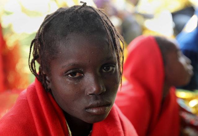 A migrant child is seen after she was rescued  from an overcrowded raft, as lifeguards from the Spanish NGO Proactiva Open Arms rescue all 112 on aboard, including two pregnant women and five children, as it drifts out of control in the central Mediterranean Sea, some 36 nautical miles off the Libyan coast January 2, 2017. (Photo by Yannis Behrakis/Reuters)