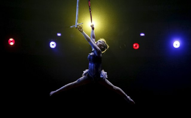 """An acrobat performs during """"Stars and starlets"""", a new programme, at the National Circus in the Ukrainian capital of Kiev April 30, 2015. (Photo by Gleb Garanich/Reuters)"""