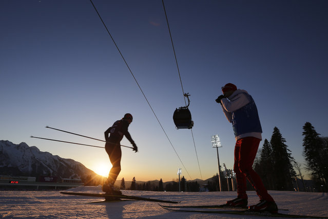 Norwegian biathlete Vetle Sjaastad Christiansen, left, trains as his coach records him at Laura Cross-country Ski & Biathlon Center ahead of the 2014 Winter Olympics, Monday, February 3, 2014, in Krasnaya Polyana, Russia. (Photo by Felipe Dana/AP Photo)