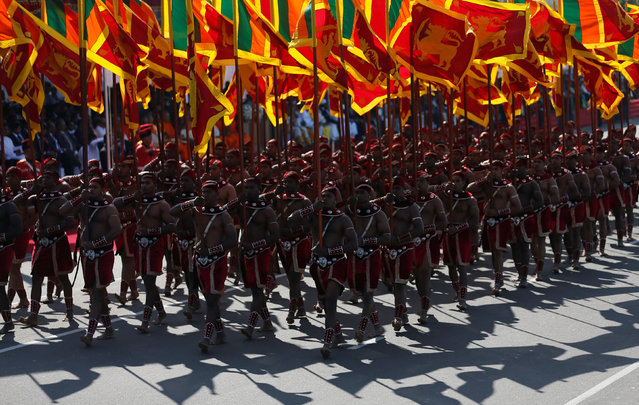 Members from the Sri Lankan military march with national flags during Sri Lanka's 69th Independence day celebrations in Colombo, Sri Lanka February 4, 2017. (Photo by Dinuka Liyanawatte/Reuters)