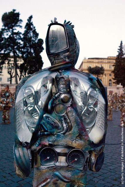 Trash People, life-size representations of people created from consumer refuse like tin cans and metal containers, created by German artist Ha Schult, populate the Piazza del Popolo on March 23, 2007 in downtown Rome, Italy