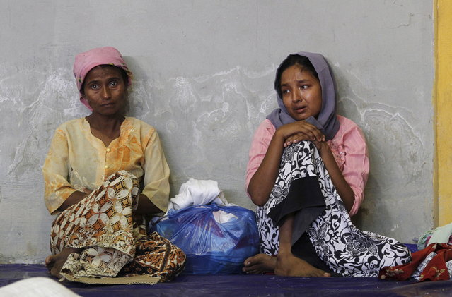 Migrants believed to be Rohingya rest inside a shelter after being rescued from boats, in Lhoksukon, Indonesia's Aceh Province May 11, 2015. (Photo by Roni Bintang/Reuters)
