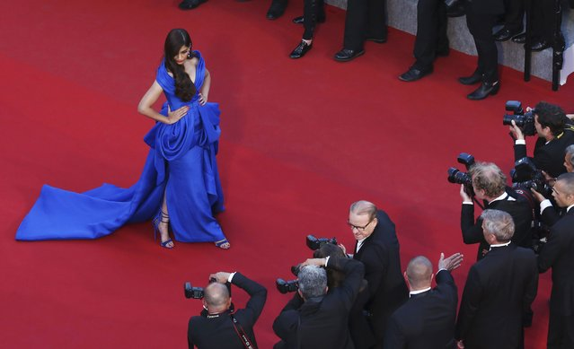 "Indian actress Sonam Kapoor poses on the red carpet as she arrives for the screening of the film ""The Sea of Trees"" in competition at the 68th Cannes Film Festival in Cannes, southern France, May 16, 2015. (Photo by Vianney Le Caer/Reuters)"