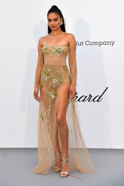 Australian model Shanina Shaik poses as she arrives on May 23, 2019 for the amfAR 26th Annual Cinema Against AIDS gala at the Hotel du Cap-Eden-Roc in Cap d'Antibes, southern France, on the sidelines of the 72nd Cannes Film Festival. (Photo by Alberto Pizzoli/AFP Photo)