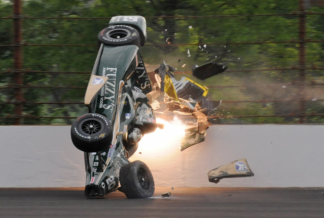 Ed Carpenter hits the wall in the second turn during practice before qualifications for the Indianapolis 500 auto race at Indianapolis Motor Speedway in Indianapolis, Sunday, May 17, 2015. Carpenter walked away from the crash and has been released from he track hospital after being checked. (Photo by Greg Huey/AP Photo)