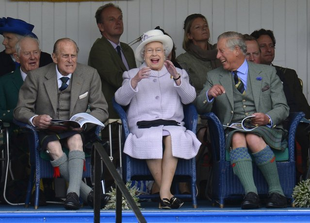 Members of Britain's royal family (front L-R) Prince Philip, Queen Elizabeth and Prince Charles cheer during the Braemar Gathering in Braemar, Scotland in this September 1, 2012 file photo. (Photo by Russell Cheyne/Reuters)