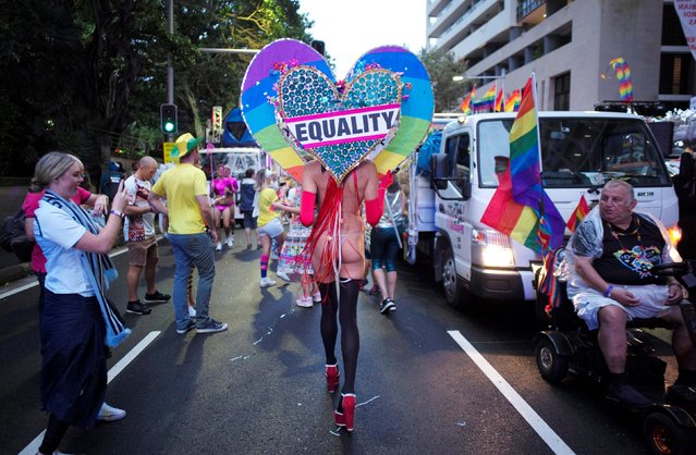 """One participant wears a giant heart, with the word """"EQUALITY"""" written on it during the annual Sydney Gay and Lesbian Mardi Gras festival in Sydney, Australia March 4, 2017. (Photo by Jason Reed/Reuters)"""