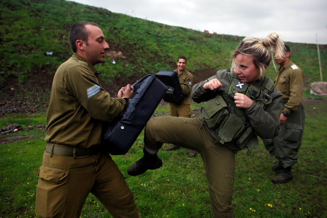 A female Israeli soldier from the Haraam artillery battalion takes part in a training session in Krav Maga, an Israeli self-defence technique, at a military base in the Israeli-occupied Golan Heights March 1, 2017. (Photo by Nir Elias/Reuters)