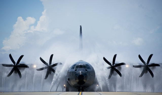 A 53rd Weather Reconnaissance Squadron WC-130 Hercules is hosed down after completing a flight over the Gulf of Mexico. The water pressure removes salt that accumulates on the aircraft when it flies through storms over the ocean. (Photo by Andrew Lee, SSgt., USAF/Defense Media Activity)