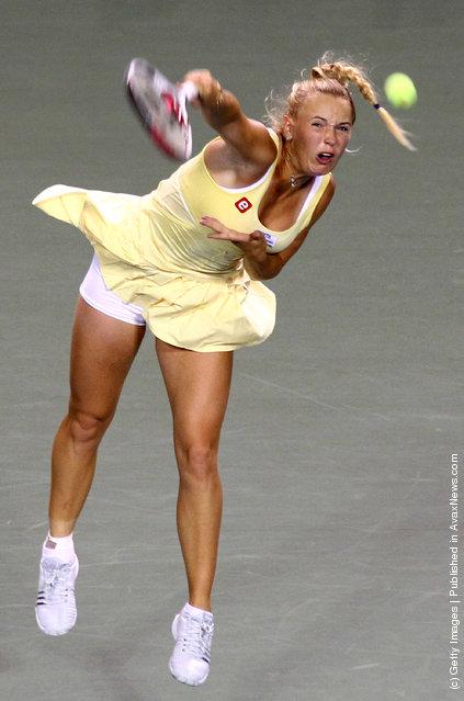 Caroline Wozniacki of Denmark serves in her match against Kaia Kanepi of Estonia