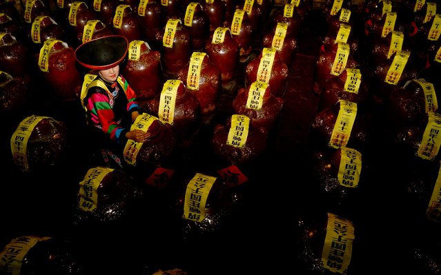 People maintain the Cellared Qing Ke beer in Huangzhong County, Qinghai Province, China on August 6, 2019. (Photo by Costfoto/Barcroft Media via Getty Images)