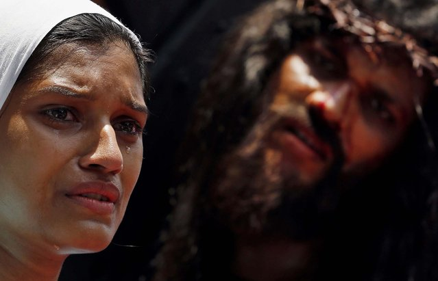 Christian devotees re-enact the crucifixion of Jesus Christ to mark Good Friday in Mumbai, India, on April 18, 2014. (Photo by Rajanish Kakade/Associated Press)
