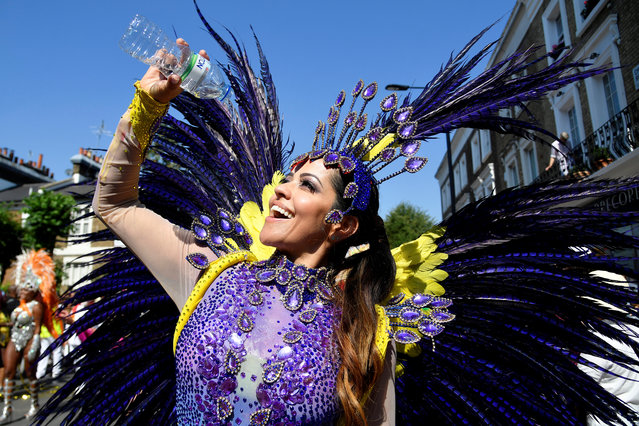 A reveller takes part in the Notting Hill Carnival in London, Britain on August 26, 2019. (Photo by Toby Melville/Reuters)