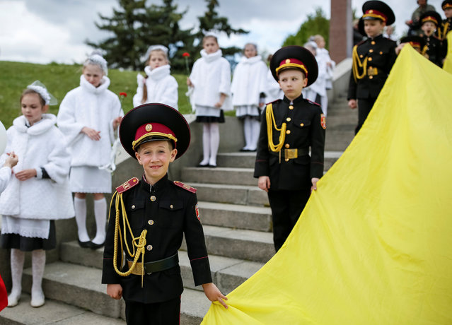 Young military cadets take part in a ceremony to mark the 71st anniversary of the victory over Nazi Germany in World War Two in the World War Two museum in Kiev, Ukraine, May 6, 2016. (Photo by Gleb Garanich/Reuters)