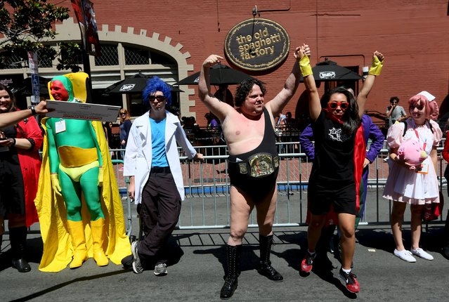 Cosplay enthusiasts engage in a costume contest in the Gaslamp Quarter at the 2015 Comic-Con International in San Diego, California July 10, 2015. (Photo by Sandy Huffaker/Reuters)