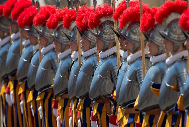 Vatican Swiss guards line up during a swearing-in ceremony, at the Vatican, Tuesday, May 6, 2014. The ceremony is held each May 6 to commemorate the day in 1527 when 147 Swiss Guards died protecting Pope Clement VII during the Sack of Rome. (Photo by Alessandra Tarantino/AP Photo)