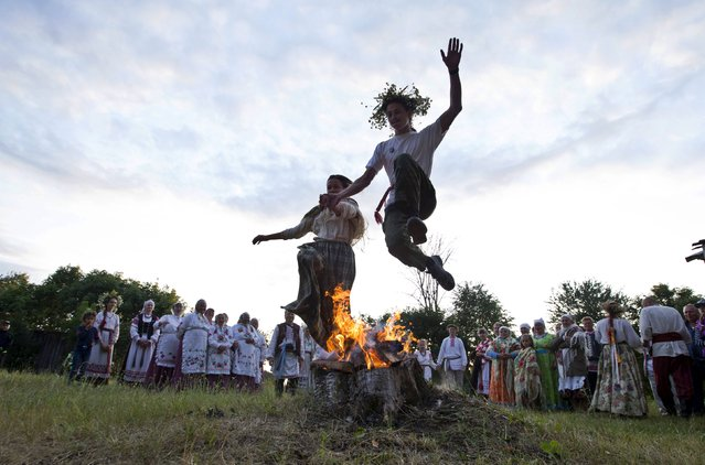 """People take part in the festival of national traditions """"Piatrovski"""" in the village of Shipilovichi, south of Minsk, July 12, 2015. (Photo by Vasily Fedosenko/Reuters)"""