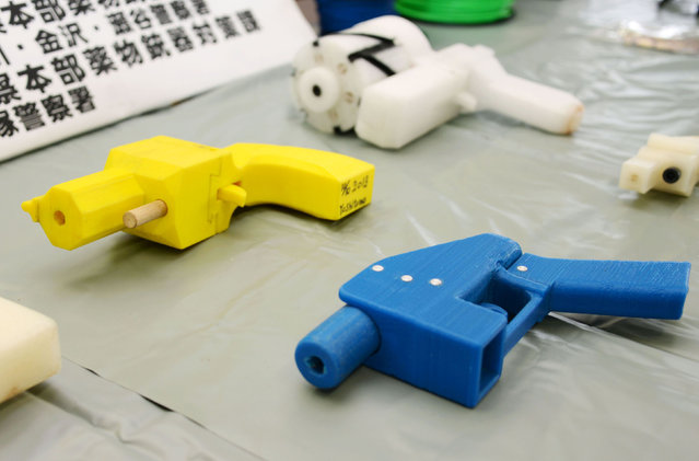 Seized plastic handguns which were created using 3D printing technology are displayed at Kanagawa police station in Yokohama, south of Tokyo, in this photo taken by Kyodo May 8, 2014. (Photo by Reuters/Kyodo)