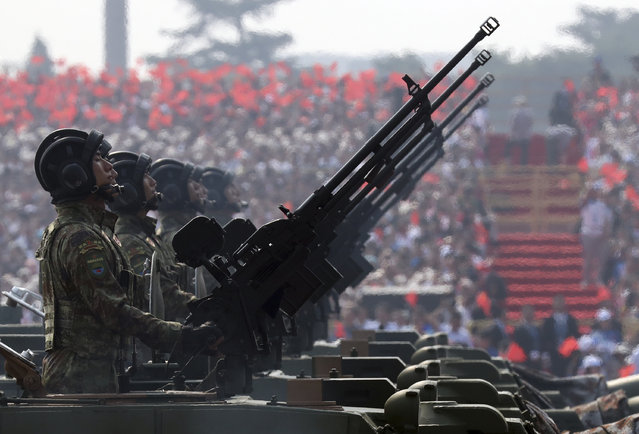 Army vehicles roll down during a parade to commemorate the 70th anniversary of the founding of Communist China in Beijing, Tuesday, October 1, 2019. (Photo by Ng Han Guan/AP Photo)