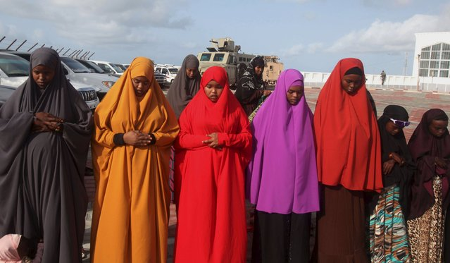 Women take part in morning prayers to celebrate the first day of the Muslim holiday of Eid-al-Fitr, marking the end of the holy month of Ramadan, in Somalia's capital Mogadishu, July 17, 2015. (Photo by Ismail Taxta/Reuters)