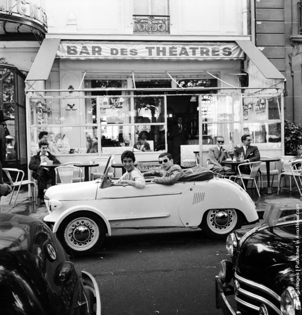 1955: French model Suzette Clairy takes her boyfriend for a spin in a Reyonnah, a narrow runabout vehicle named after its inventor, Monsieur Hannoyer. The front wheels can be drawn in to enable the car to pass into a tight parking space, or even through a doorway