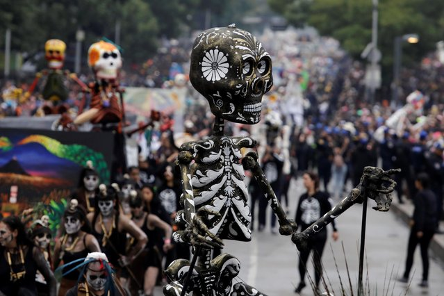 A Mexican float participates in the Day of the Dead parade in Mexico City, Mexico on November 2, 2019. (Photo by Luis Cortes/Reuters)