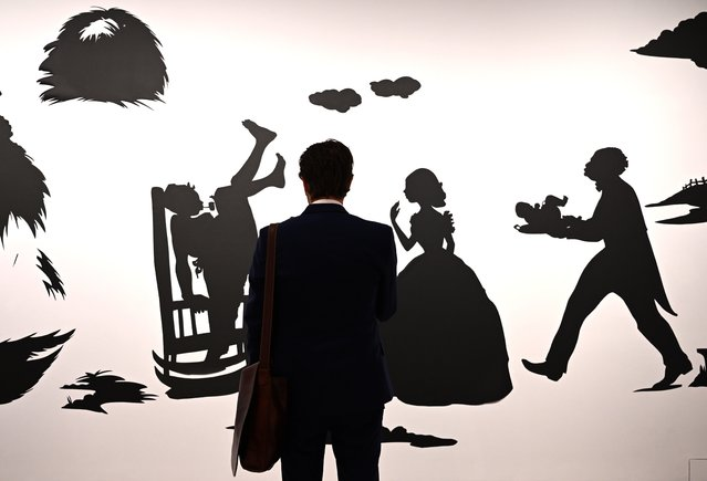 "A person looks at Kara Walker's ""Being the True Account of the Life of the Negress"" during a press preview on November 1, 2019, for the Christie's Post-War and Contemporary Art Evening Sale in New York on November 13. (Photo by Timothy A. Clary/AFP Photo)"