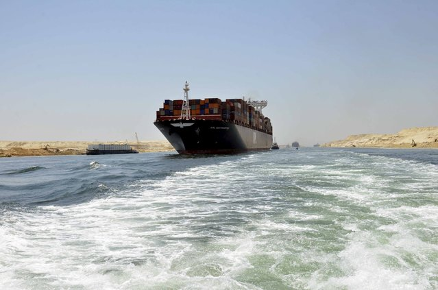 A cargo ship is seen crossing through the New Suez Canal, Ismailia, Egypt, July 25, 2015. (Photo by Reuters/Stringer)