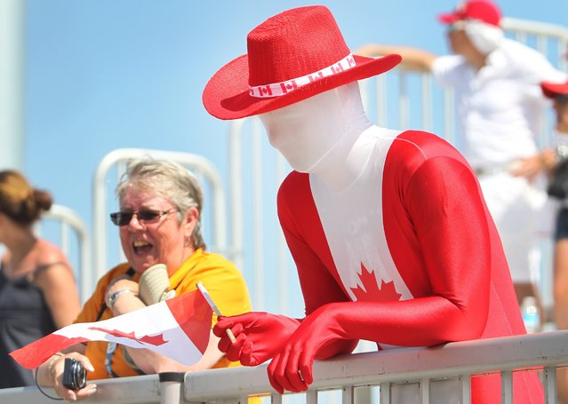 A Canadian fan watches the gold medal women's baseball game between Canada and USA at the Pan Am Games in Ajax, Ontario, Sunday, July 26, 2015. The United States won the gold medal in the event. (Photo by Fred Thornhill/The Canadian Press via AP Photo)