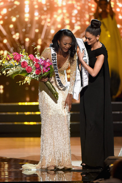 Miss District of Columbia USA 2016 Deshauna Barber (L) reacts as Miss Universe 2015 Pia Wurtzbachshe gives her the winner's sash as she is named Miss USA 2016 during the 2016 Miss USA pageant at T-Mobile Arena on June 5, 2016 in Las Vegas, Nevada. (Photo by Ethan Miller/Getty Images)