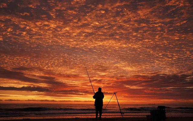 A fisherman on Whitley Bay beach in Northumberland, England at sunrise, October 5, 2019. (Photo by Owen Humphreys/PA Images via Getty Images)