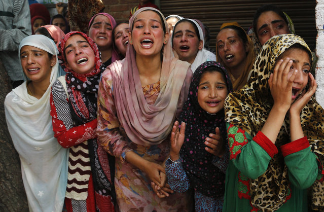 Kashmiri village women and young girls wail as the body of Indian policeman Tasveer Ahmad arrive for his funeral at Surasyar village about 38 kilometers (24 miles) southwest of Srinagar, Indian controlled Kashmir Saturday, June. 17, 2017. Six police were killed Friday when rebels fighting against Indian rule ambushed a police vehicle in Indian-controlled Kashmir, while two civilians were killed and several others injured in clashes that erupted during a gunbattle between rebels and government forces in the disputed region, officials and witnesses said. (Photo by Mukhtar Khan/AP Photo)